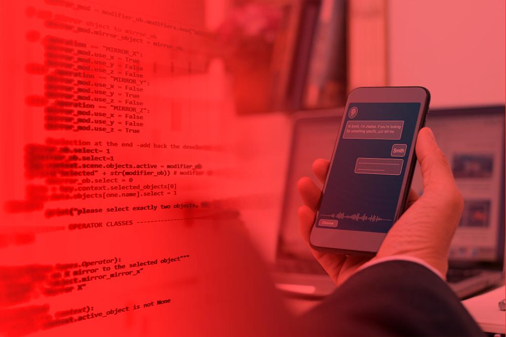 Mão de homem de negócios segurando um aparelho celular com um chatbot em conversação